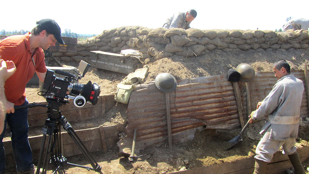 Jordan Paterson filming a WWI trench